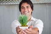 Happy Man Holding Plant — Stock Photo