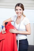 Female Dressmaker Adjusting Clothes — Stock Photo