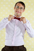 Geek Adjusting Bowtie — Stock Photo