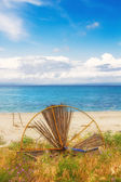 HDR image of a broken umbrella on the beach in Hanioti — Stock Photo