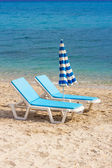 Two blue lounge chairs on a beach in Hanioti — Stock Photo