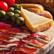 Platter of antipasti appetizers, with crusty bread — Stock Photo #11999991