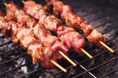 Pork skewers on a grill — Stock Photo
