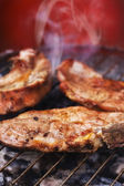 Pork chops on a grill — Stock Photo