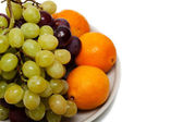 Grapes and oranges — Stock Photo