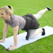 Middle aged woman exercising — Stock Photo #10780424