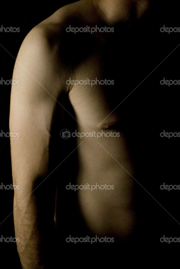 Sexy fit naked male body on black background low key — Stock Photo #10780044