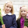 Girls with flowers - first day of school — Stock Photo