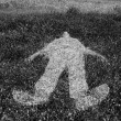 Human figure outline imprinted on grass - 图库照片