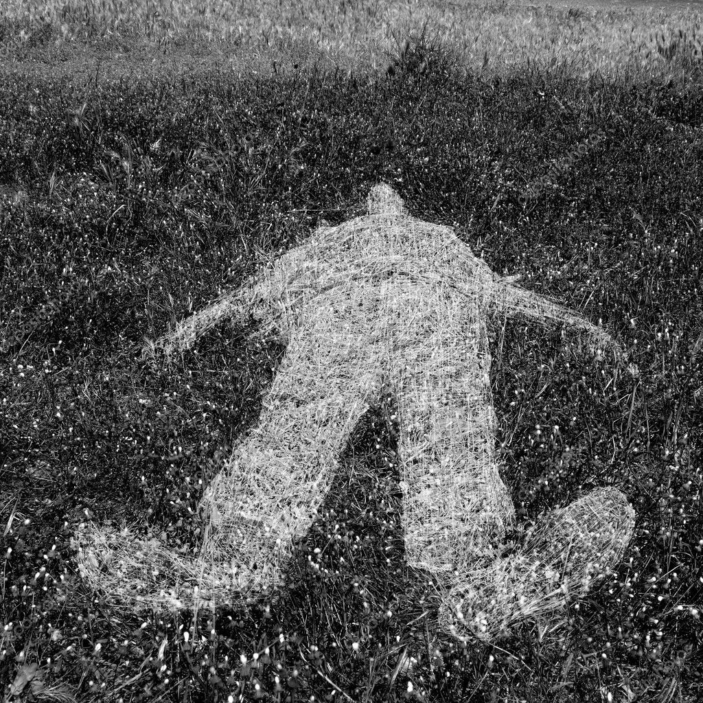 Reclining human figure outline imprinted on grass. Black and white. — Stock Photo #11009497