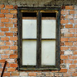 Stock Photo: Stained brick wall and boarded up window