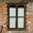 Stained brick wall and boarded up window — Stock fotografie