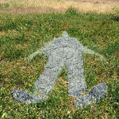Human figure imprinted on grass — Stockfoto
