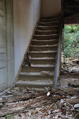 Old wooden staircase and dirty floor — Stock Photo