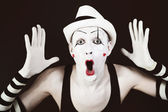 Ape mime in striped gloves and white hat — Stock Photo