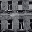 Stock Photo: Windows of old dilapidated city buildings