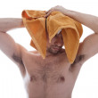 Naked man wiping his wet hair yellow towel — Stock Photo