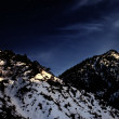 Mountain winter landscape with yellow moon — Stok fotoğraf