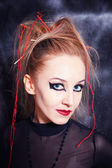 Young woman with bright gothic makeup closeup — Stock Photo