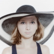 Young girl in summer hat closeup — Stock Photo