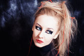Young woman with bright gothic makeup — Photo