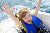 Travel of children on water in the boat — Stock Photo