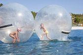 Joyful children in a balloon floating on water. — Stock Photo