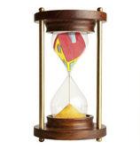 Přesýpací hodiny a dům — Stock fotografie