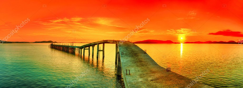 Sunset over the sea. Pier on the foreground. Panorama  Stock Photo #11486333