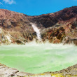 Hot acid lake in volcanic crater — Stock Photo