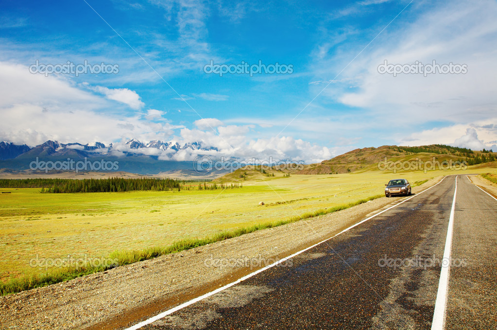 Car at the roadside and mountains on background — Stock Photo #11539747