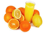 Glass of juice and tropical fruits — Stock Photo