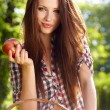 Beautiful woman in the garden with apples — Stock Photo #10805944