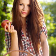 Beautiful woman in the garden with apples — Stock Photo