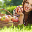 Beautifuwoman  in the garden with apples - Stock Photo