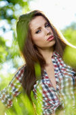 Beautiful young woman in garden — Stock Photo