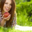 Beautiful  woman in the garden with apples - Lizenzfreies Foto