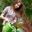 Portrait of an attractive female water plants with a watering ca — Stock Photo