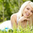 Girl on green field — Stock Photo #11219507