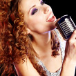 Woman holding a retro microphone - Stock Photo