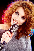 Woman holding a retro microphone — Stock Photo