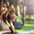Portrait of a young beautiful girl with red apple on a backgroun — Stock Photo #11552134
