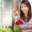 Portrait of a young beautiful girl with red apple on a backgroun — Stock Photo #11552640