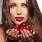 Woman with cherries — Stock Photo #11660919