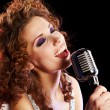 Beautiful brunette woman singing — Stock Photo