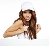 Sexy girl holding a blank billboard. — Stock Photo