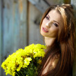 Woman holding yellow flowers . outdoor shoot — Stock Photo #11755752