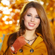 Young brunette woman portrait in autumn color — Stock Photo #11798528