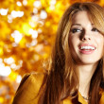 Young brunette woman portrait in autumn color — Stock Photo #11798564