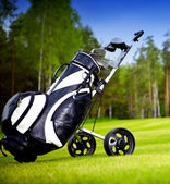 A set up new golf clubs on a beautiful golf course — Stock Photo